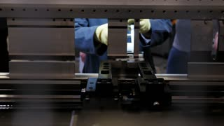 Worker at automate machine on Industrial factory
