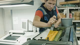 Worker at Polygraphy printing industry use Yellow paint on ink roller