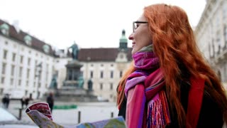 Young red hair woman using city map in Vienna, wide angle, close up