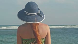 Young woman looking at the sea on tropical beach, close up, Dominican Republic