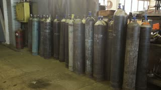 Acetylene and gas steel storage tanks for welding.Bottled gas cylinders.Oxygen tanks.Gas energy container representing storage and danger.Industrial gas cylinders