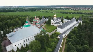 Aerial view of the ancient monastery, the church in the forest,castle,walls,church building. Orthodox Christian monastery. 4K video,ultra HD