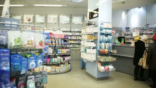 Buyers at the pharmacy store. Healthcare Products For Sale In Cosmetics And Healthcare Store in Russia. Pharmacy store drugs. Drugstore, cosmetics, health store. Beautiful interior of the store