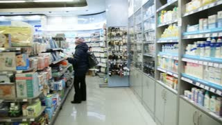 Buyers at the pharmacy store.Healthcare Products For Sale In Cosmetics And Healthcare Store in Russia.Pharmacy store drugs.Drugstore, cosmetics, health store.Beautiful interior of the store pharmacy