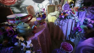 Decor in the style of Alice in Wonderland. Festive table decoration wedding banquet. Interior of a wedding hall decoration ready for guests. Beautiful room for ceremonies and weddings. Wedding concept
