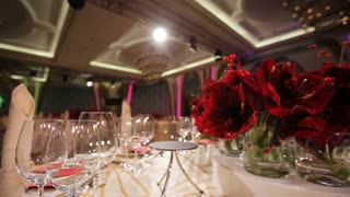 Festive table decoration wedding banquet.Interior of a wedding hall decoration ready for guests.Beautiful room for ceremonies and weddings.Wedding concept.Luxury stylish wedding reception purple