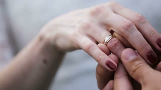 groom's and bride's hands putting the wedding ring  during wedding ceremony.Groom put a ring on finger of his lovely wife. Wedding couple together.Wedding concept