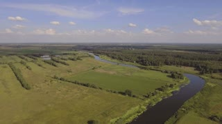 Landscape with river, forest, clouds, blue sky. Flying over the river and green fields. Aerial View. Aerial video. 4K,UHD Aerial Rural landscape