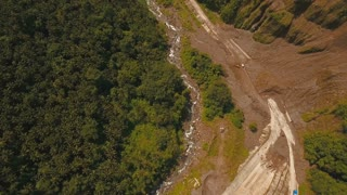 Landslides and rockfalls on the road in the mountains. Aerial view: mud and rocks blocking the road. Destroyed rural road landslide damaged in powerful flood. Collapsed on the mountain. Philippines