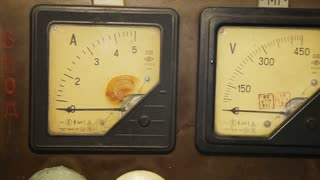 Old industrial electronics gauge instruments. Close-up of an vintage ancient voltmeter. Vintage analog scale with pointer in right half of scale. Old ammeter. Electric measuring device