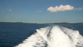 Water trace formed from powerful speed ferry engines, cruising at high speed. Trail on sea surface behind of speed boats. Water trail foaming behind a ferry. K video Travel concept