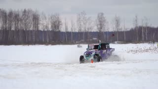 Winter racing side-by-side vehicles. Rally on the buggy on the snow on a winter day. Racing in the SXS class. Buggy, sports car on rally. Off Road Series racing. Slow motion