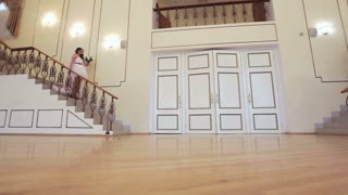 Wedding couple on stairs.Bride and groom walk down the stairs and go to meet each other.Wedding concept.