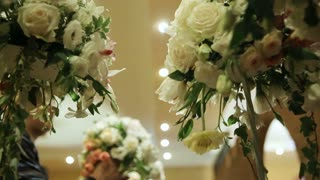 Wedding decorations with flowers. Interior of a wedding hall decoration ready for guests. Beautiful room for ceremonies and weddings. Wedding concept. Luxury stylish wedding reception purple