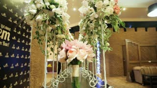 Wedding decorations with flowers.Interior of a wedding hall decoration ready for guests.Beautiful room for ceremonies and weddings.Wedding concept.Luxury stylish wedding reception purple decorations