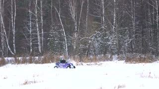 Winter off-road racing side-by-side vehicles. Rally on the buggy on the snow on a winter day. Racing in the SXS class. Buggy, sports car on rally. Off Road Series racing. Slow motion