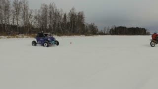 Winter racing side-by-side vehicles. Rally on the buggy on the snow on a winter day. Racing in the SXS class. Buggy, sports car on rally. Off Road Series racing. 4K video
