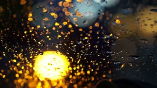 Abstract blur traffic lighting in the rain with bokeh