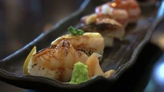 Aburi nigiri set or seared sushi set. Japanese food, raw fish with fast fire burn