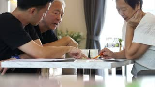 Asian Father and son discuss real estate invest. Buying house or condominium. Talking about finance, profit and return