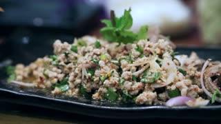 Asian girl enjoy eating tasty Thai food, Papaya salad and other spicy food