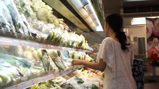 Asian girl, woman shopping for food in wholesale supermarket