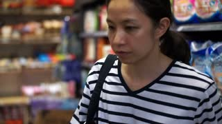 Asian girl, woman shopping house supplies in supermarket