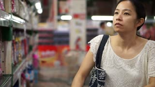 Asian girl, woman walking, looking and shopping snacks in supermarket isle