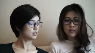 Asian girls working online at home together. Startup concept business