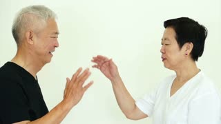 Asian happy couple high five and hold hands on white background