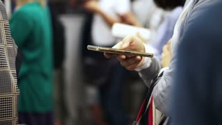Asian people hands using smartphone in subway train riding. Modern world internet connection