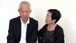 Asian senior couple comforting and consoling each other, dealing with problem together