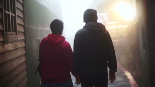 Asian senior couple walking and holding hands together in the mist. Travel and see the world together