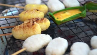 Asian style of food preservation, grill left over sticky rice with egg and salt. Egg on banana leaf