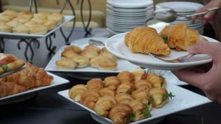 Assortment Sandwiches buffet, wedding reception. Light meal food, croissants and breads