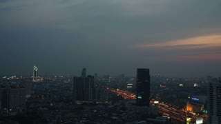 BANGKOK, THAILAND - APRIL 2015: Time lapse view of Bangkok skyline at sunset