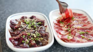 Barbecue party. Sliced raw beef on grill, Asian yakiniku