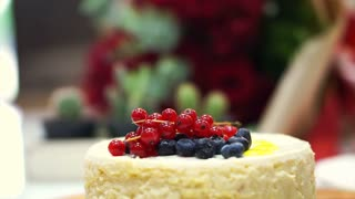 Beautiful berry cheese cake on festival decorated table
