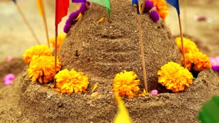 Beautiful decorate sand castles with flags and flowers for Thai New Year festival
