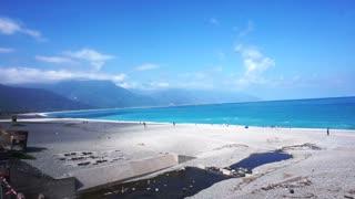 Beautiful pan shot HD video of the bright blue ocean and mountain in Haulien,Taiwan