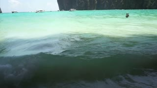 Beautiful tropical beach and cave limestone mountain in Phi Phi island of Thailand