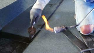 Bitumen roofing, asphalt installation with fire