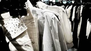 Black and white theme clothes hanging in fashion shop racks