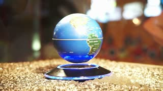 Blue Planet Earth background Globe spinning on magnetic power model