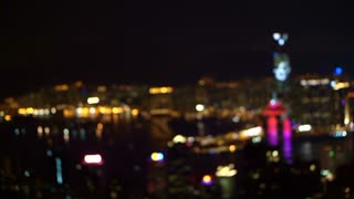 Blur background view of World famous skyline Hong Kong harbour at night. Tourist landmark popular view