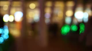Blur holiday light bokeh background with people shadow walking