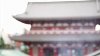 Blur shot of Japanese people praying at Senso-ji temple, Landmark temple in Asasuka, Tokyo, Japan