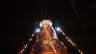 Buddhist Pagoda with festival stripe light during religious holiday