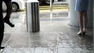business building wet floor and people standing wait for rain to stop abstract hope in crisis