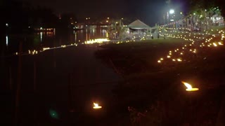 Candle lit at night to pay respect to river goddess at Loi Krathong festival Thailand.